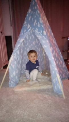 happy kid in the teepee!