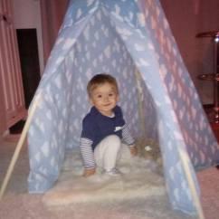 happy kid in the teepee!